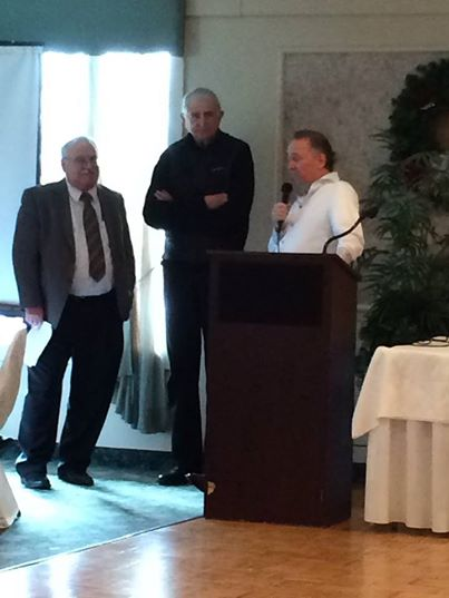 Honoring Al Levine at holiday party 2014